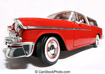 Picture of a 1955 classic US car. Taken with a fisheye lens as a highkey picture. Very hard to flash as the frontlens is only 3 cm away from the object.(a lot of reflectors were placed at the sides and round the lens) Detailed scale model from my brothers toy collection.