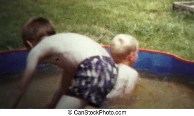 1957 - Boys Playing In Small Splash - Original vintage 8mm...