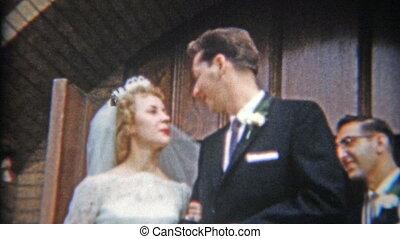 1957: Newlywed couple leaving - Original vintage 8mm film...