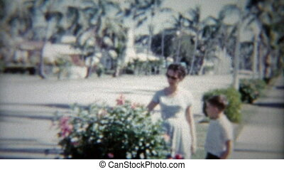 1959: Mom and son of tree lined - Vintage 8mm film home...