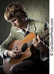 1960s style guitarist - Vintage guy playing acoustic guitar ...