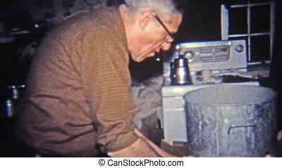 1965: Man enjoying cream dip on - Original vintage 8mm film...
