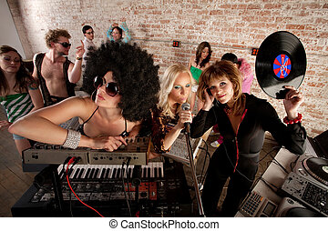 1970s Disco Music Party - Cool female DJs performing at a...