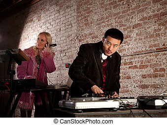 1970s Disco Music Party - Cool DJ with turntable and blonde...