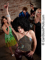 1970s Disco Music Party - Pretty girl with afro wig at a...