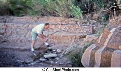 1971: Man filling water bottle from