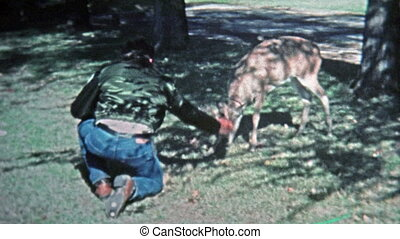 1971: Man playing with young pet - Unique vintage 8mm film...
