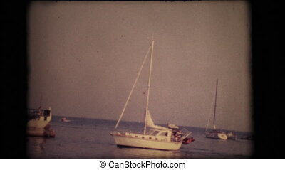 Vintage 8mm. Boats at the entrance of the port of Sanremo