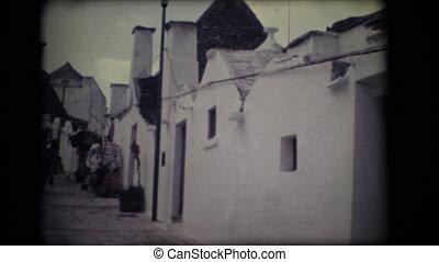 Vintage 8mm. Narrow alley in Alberobello