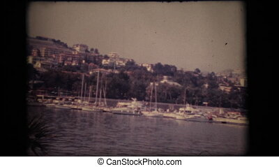 Vintage 8mm. View of port and sailing boats