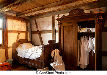 Old bedroom of 1900 in the eco museum of Ungersheim, Alsace, France