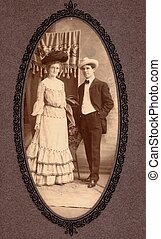 A couple poses for the camera during the 19th Century
