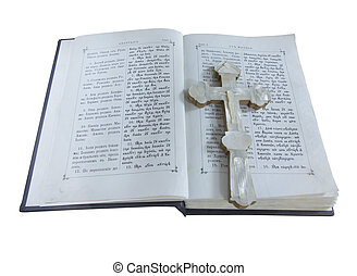 19th Century old bible and cross isolated over white