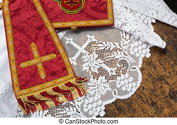 19th century red damask chalice veil and maniple on a white lace catholic priest surplice