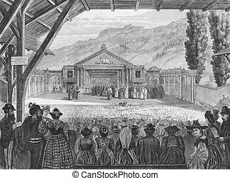 19th century theatre of the Oberammergau Passion Play on engraving from the 1800s. Published by The Graphic in 1870 from a sketch by H.Harral.