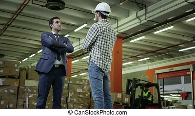 1of19 People working in warehouse - Adult business man in...