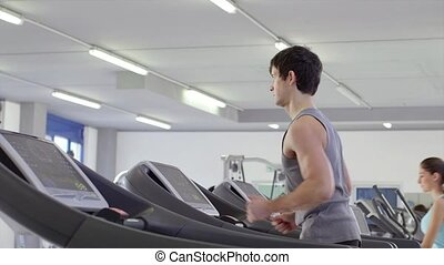 1of27 People training in gym