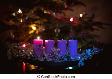 1st advent advent candle burning  in pink color