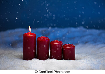 1st Advent candles in snow and snowfall