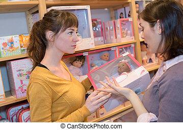 2 여자, 에서, a, 장난감 상점