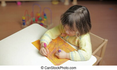 2-3 years old girl drawing in kindergarten - child drawing...