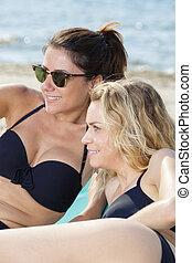 2 beautiful women on the beach
