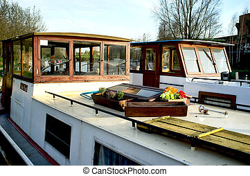 2 boathouses on canal