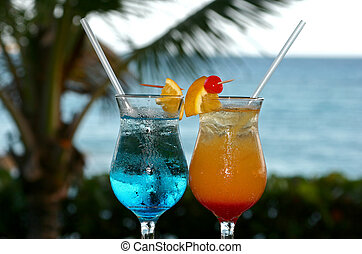 2 colourful cocktails waiting to be drunk
