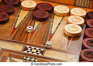 2 dice on the backgammon desk