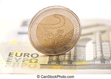 2 euro coins on banknotes