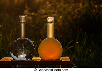 2 glass flasks with samples of clean and dirty water