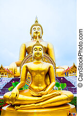 normal golden Buddha statue in front of Biggest golden color Buddha in Thailand