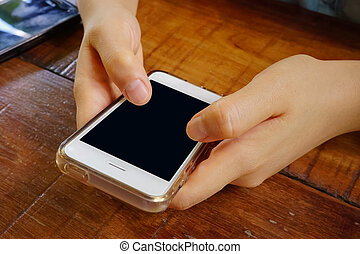 2 Hands holding mobile smart phone with blank screen.