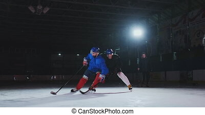 2 hockey players fighting for puck, legs, skates close view.