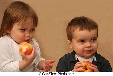 2 kids with apples
