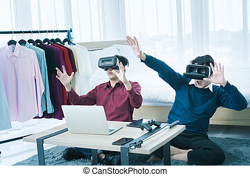 2 men watching movies with 3D system