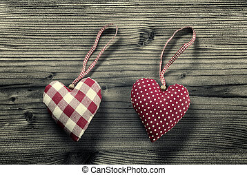 2 pieces of fabric hearts, polka dots , plaid, on wood background