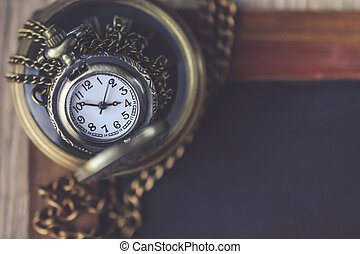 2 Pocket Watch with the Chain on the Black Board with Blank Space