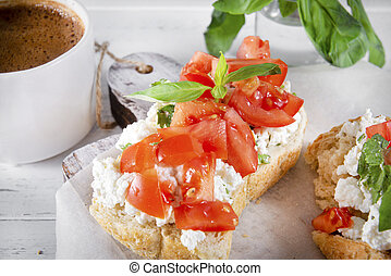 sandwiches with soft cheese, tomato slices and Basil, a Cup of black coffee, on a white wooden background, Breakfast,