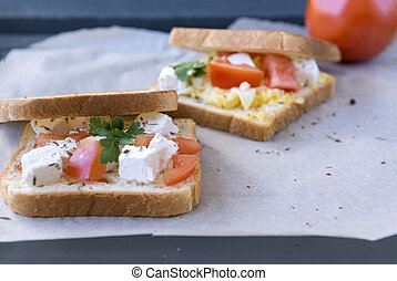 sandwiches with tomato, cheese and herbs