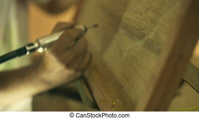 2 Sculptor Painter Artist Chiseling A Wooden Bas Relief