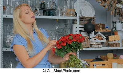 2 shots. Professional florist holding bouquet of red roses at studio