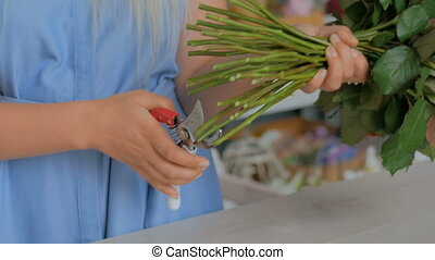 2 shots. Professional florist working at flower store - 2...