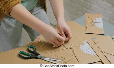 2 shots. Two professional women decorators making envelopes...