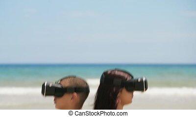 2-Teenagers Girlfriend Boyfriend Playing Virtual Reality On Beach