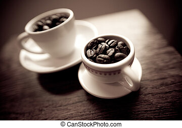 2 white coffee mugs on white plates - Two white coffee mugs...