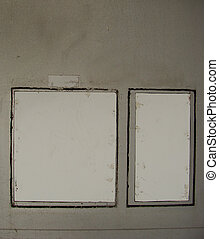 2 white grungy frames on a gray striped wall