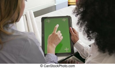 2 Women Architect Using Tablet PC With Green Screen