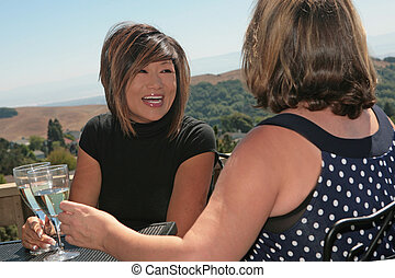 2 Women Friends Chatting and Laughing Outdoors