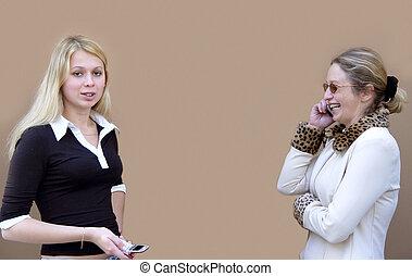 2 women with phones